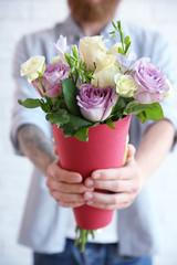 Man holding beautiful bouquet, closeup
