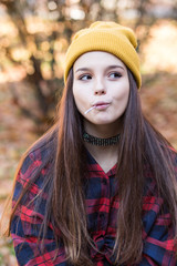 Young trendy girl biting lollipop