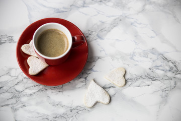 cup of espresso and cookies in the form of hearts on Valentine's Day
