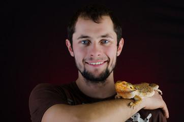 Man and australian dragon in the studio