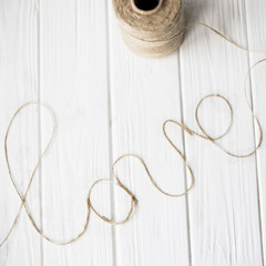 word love of twine laid out on the table