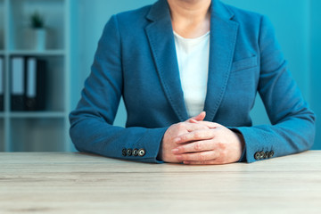 Business negotiation skills with female executive at office desk