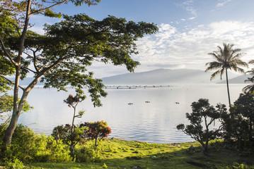 Lake Toba (Danau Toba) and fishing boats at sunrise, North Sumatra, Indonesia, Southeast Asia, Asia