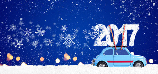 Blue retro toy car delivering Christmas or New Year 2017 on festive blue background