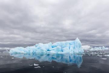 Huge blue iceberg near Petermann Island, western side of the Antarctic Peninsula, Southern Ocean, Polar Regions