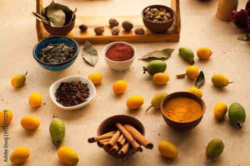 Variation of spices on wooden table in the kitchen for for 7 spices asian cuisine