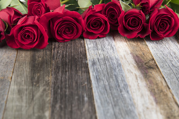Red Roses on Wooden Surface