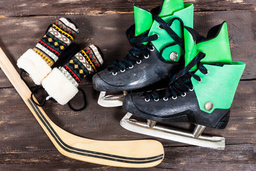 Overhead view of hockey ice skates accessories placed on old rus