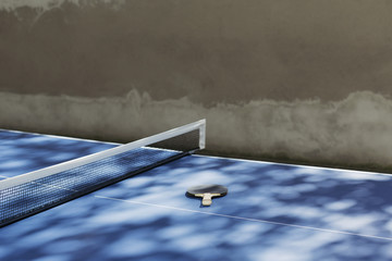 High angle view of table tennis bat by net on table