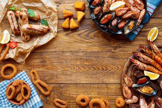 Seafood platter top view, flat lay on wooden table background
