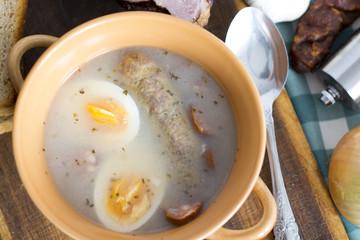 Traditional Zurek with sausage and egg, white borscht, polish Ea