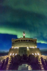 Aurora borealis (Northern Lights) dance above the Lindblad Expeditions ship National Geographic Explorer in Hudson Strait, Nunavut, Canada
