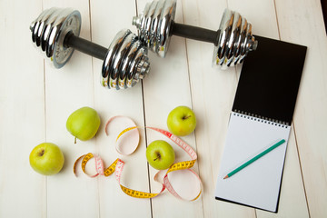 diet plan, menu or program, weight loss, measuring tape, dumbbells and dietary food fresh fruit