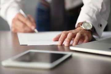 Businessman signing documents