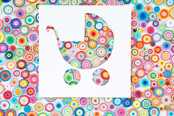 Concept of pram on colorful paper made with quilling technique o