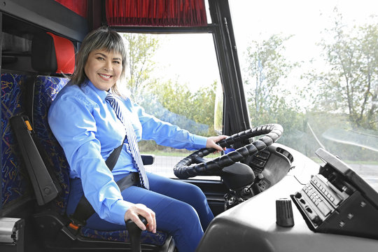 Female driver sitting in bus