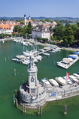 Aerial view from the lighthouse across the port and the old town with the sculpture of the Bavarian Lion, Lindau, Lake Constance (Bodensee), Bavaria, Germany
