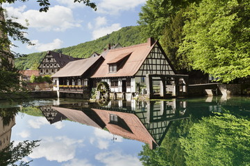 Mill reflecting in Blautopf Spring, Blaubeuren, Swabian Alb, Baden Wurttemberg, Germany, Europe