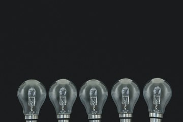 Electric bulbs on black background