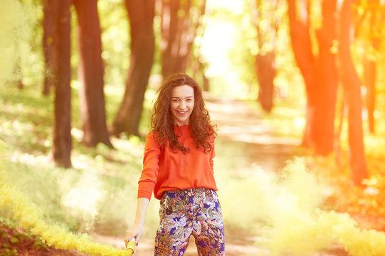hipster girl with yellow smoke bombs.