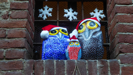 Owls painted by hand on stones