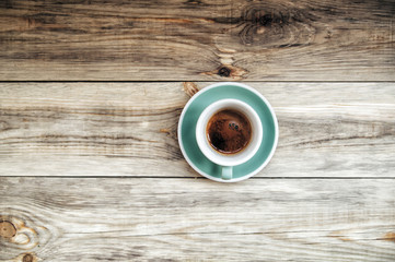 Delicious morning cup of espresso coffee on the wooden table rustic background