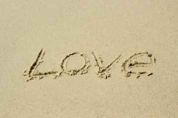 love, word drawn on the beach