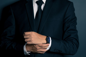Businessman Fixing Cufflinks his Suit