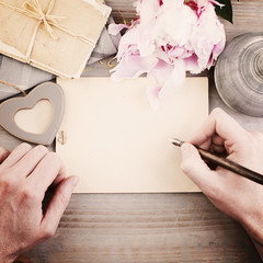 Vintage Background with Male Hands, Pen and Paper. Man Writing L