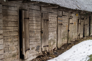 An old wooden building in a winter landscape