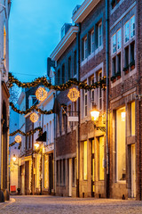 Shopping street with christmas lights in the city center of Maastricht