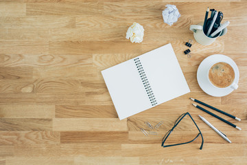 Blank notebook with glasses and coffee
