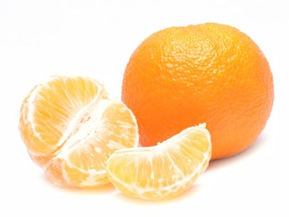 Wall Mural - Ripe mandarin with leaves close-up on a white background.