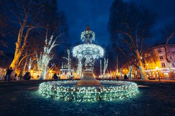 Illuminated fountain on Zrinjevac (Zagreb, Croatia), Christmas m Wall mural
