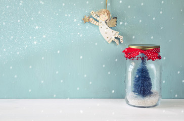 mason jar with christmas tree and flying angel