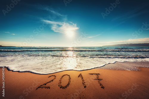 happy new year 2017 concept on the sea beach sunrsie shot