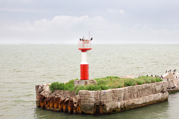 A signal lighthouse in the sea Bay. Travel photos