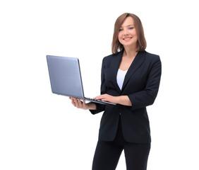 Beautiful businesswoman keeps the laptop.