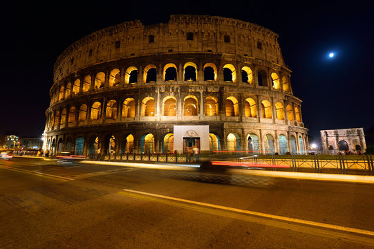 Colosseum and Arch of Constantine at night, Rome, Lazio