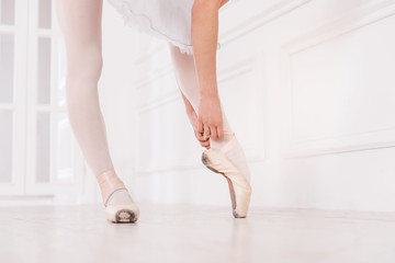 Close up of ballerina touching her ribbon