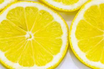 close up of fresh lemon slices on white
