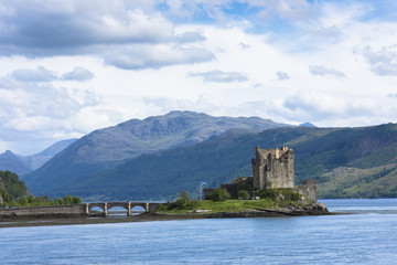 Eilean Donan Castle, a Highland fortress, with Saltire Scottish flag flying in Loch Alsh at Dornie, Kyle of Lochalsh in the western hIghlands of Scotland