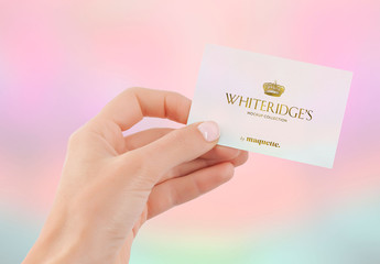 Hand with Gold-Embossed Business Card Mockup 14