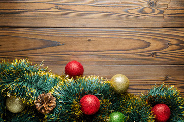 Christmas Background Theme. Christmas Balls (Red, Gold, Green) In A Tinsel On A Wooden Background. Close-Up. Top View.