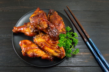 bbq chicken wings and chopsticks