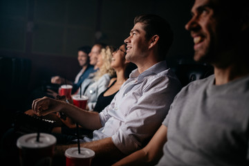 People sitting in cinema hall watching movie