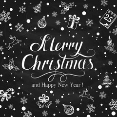 Christmas greetings with holiday decorations on black chalkboard