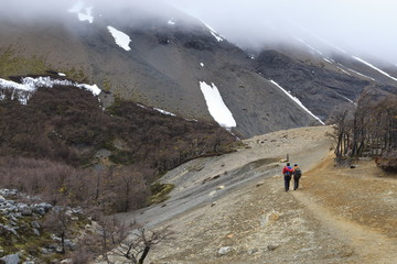 Hikers walking on a trail from the base of the Paine towers, Torres del Paine, Patagonia, Chile, South America