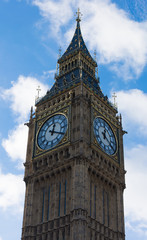 Big Ben in Westminster on blue sky and white background, London