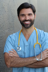 Doctor smiling with his arms crossed
